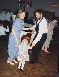 parents dancing with little daughter