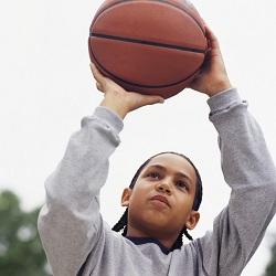 boy shooting hoops